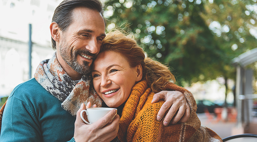 Senior couple that is enjoy coffee knowing they are protecting their wealth.